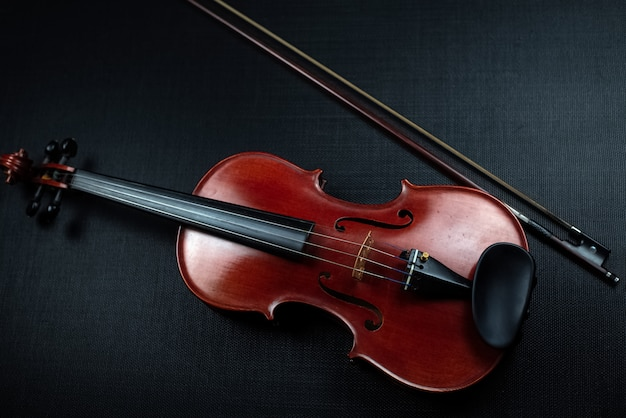 Wooden violin on dark