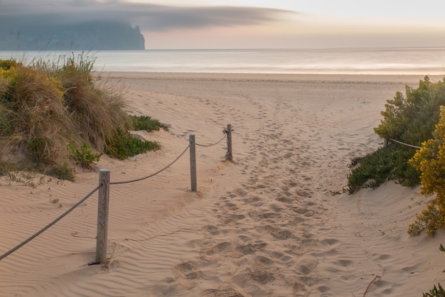 Wooden walkway entering the beach at sunrise