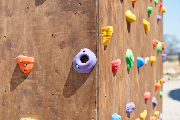 Wooden wall for climbing close up.