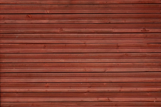 Wooden wall made of horizontal slats of red color