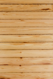 Wooden wall made of thin light unpainted boards