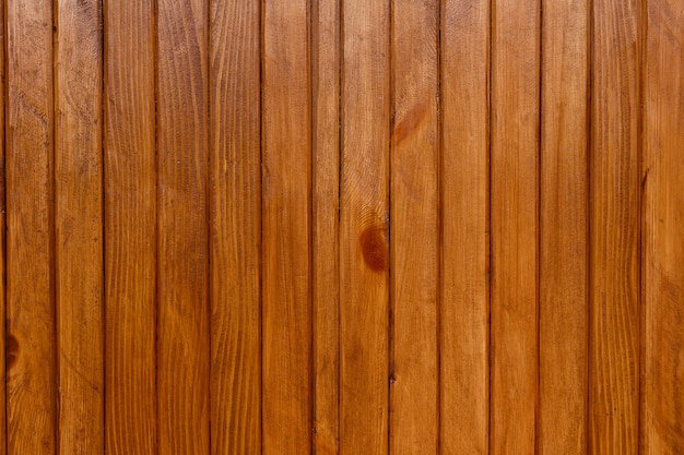 Wooden wall of thin boards painted with linseed oil