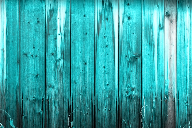 Wooden wall with a protective layer of blue paint.