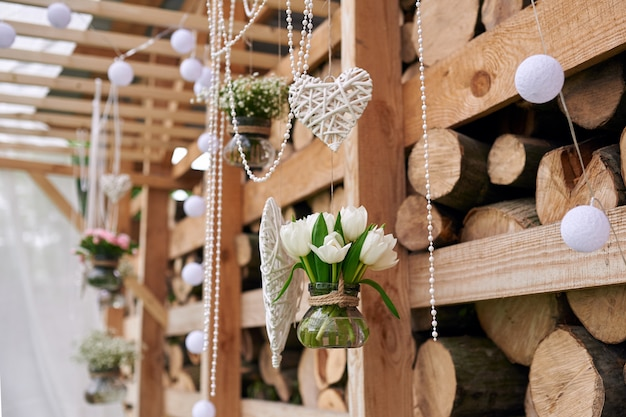 Wooden wedding decor in rustic style for ceremony