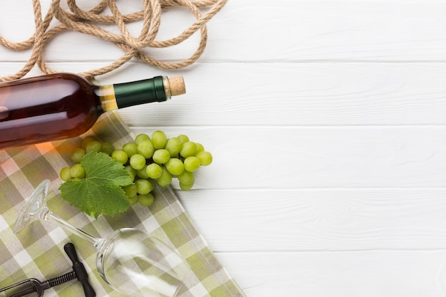 Wooden white background with wine