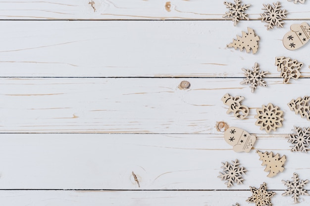 Wooden white and christmas background with snowflakes and christmas decoration.