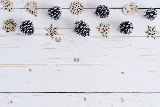 Wooden white and christmas background with snowflakes