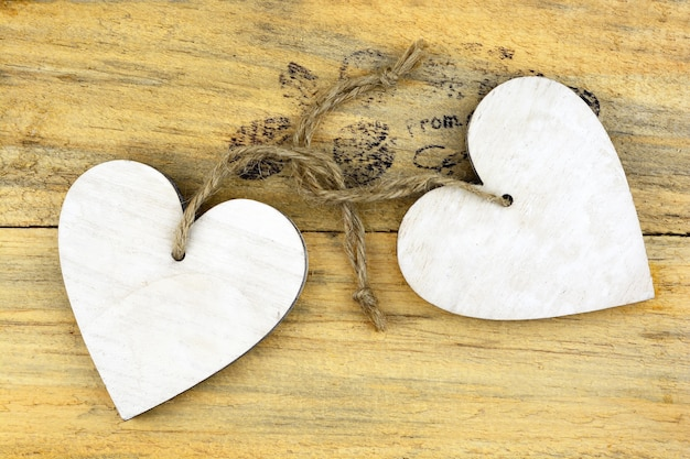 Wooden white hearts on a wooden surface