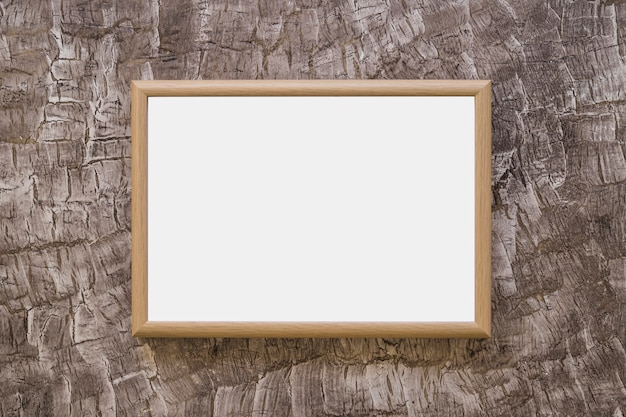 Wooden whiteboard on design wallpaper