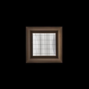 Wooden window frame on black background