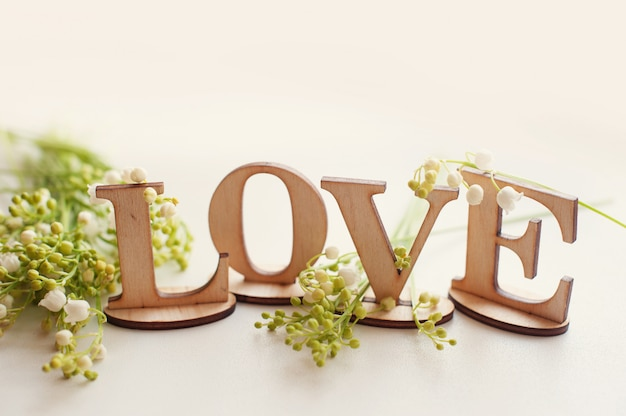 Wooden word love with lilies . valentine dating