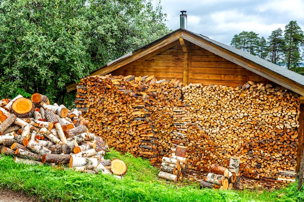 Woodpile with wood in a country house.