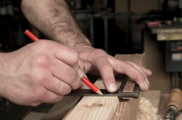 Woodworker and red pencil