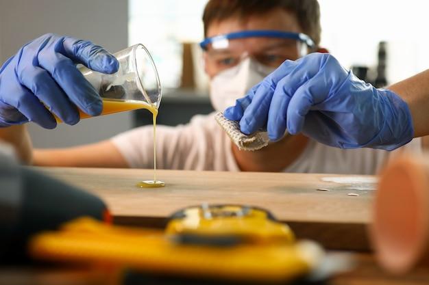 Woodworker varnishing furniture