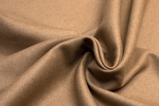 Wool fabric color beige texture background