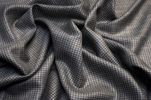 Wool fabric with silk suiting with goose foot  color is gray-brown texture background