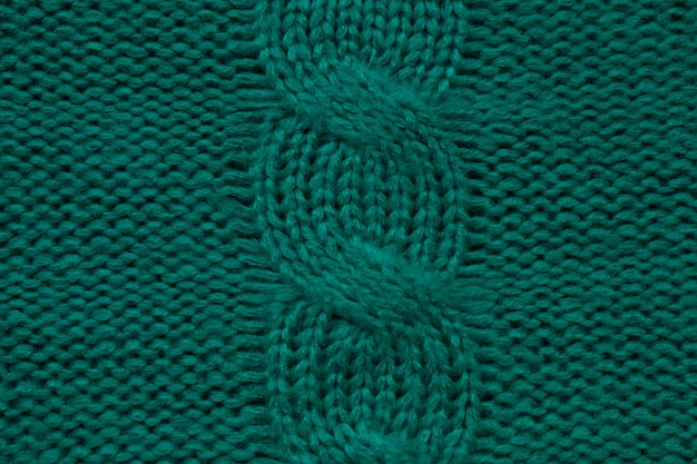 Шерстяной вязаный вручную или машинным узором с косами вязать теплый зеленый свитер или уютный шарф темного цвета ...