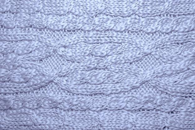 Шерстяной свитер или шарф текстуры фона. косы в машинке вязаный трикотаж фон