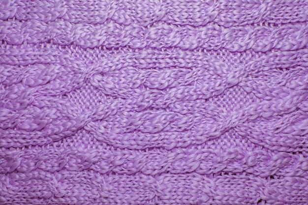 Шерстяной свитер или текстура шарфа заделывают. вязаный фон из трикотажа с рельефным узором
