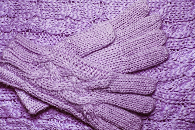 Wool sweater or scarf and gloves texture close up. knitted jersey background with a relief pattern.