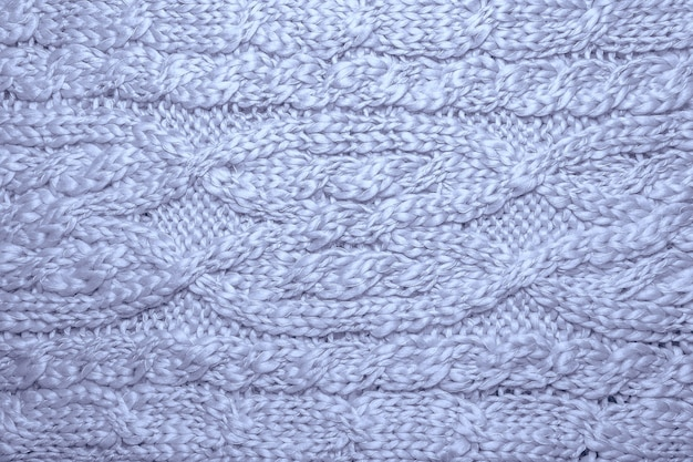 Wool sweater or scarf texture background. braids in machine knitted jersey background