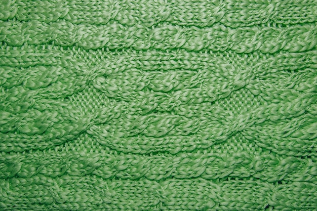 Wool sweater or scarf texture close up. knitted jersey background with a relief pattern
