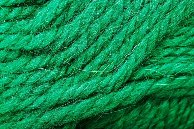 Wool yarn close-up with aquamarine threads for needlework