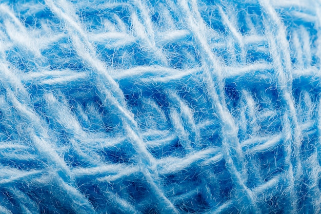 Wool yarn close-up with blue threads for needlework