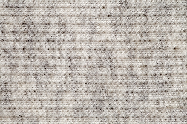Wool yarn made of white threads, background structure, close-up macro view