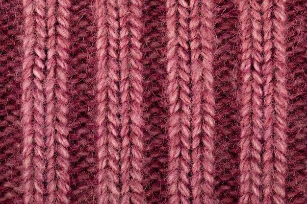 ウールニットの背景ピンク色のクローズアップ