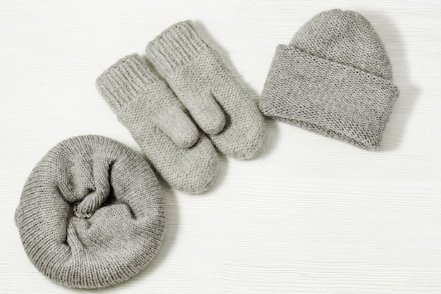 Woolen knitted clothing, wool cap, mittens and scarf. warm womans winter clothes
