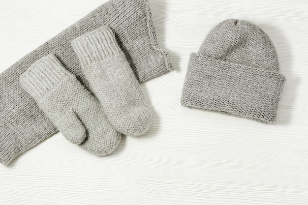 Woolen knitted clothing, wool cap, mittens and scarf.