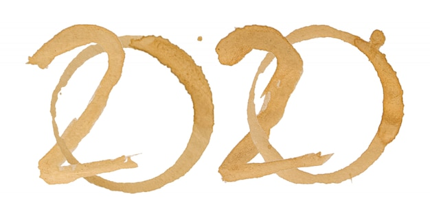 Word 2020 alphabet is made of coffee stains isolated on white