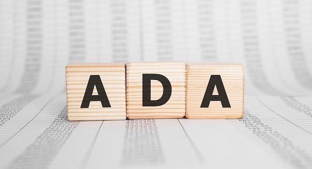 ウッドビルディングブロック、ビジネスコンセプトで作られた単語ada。