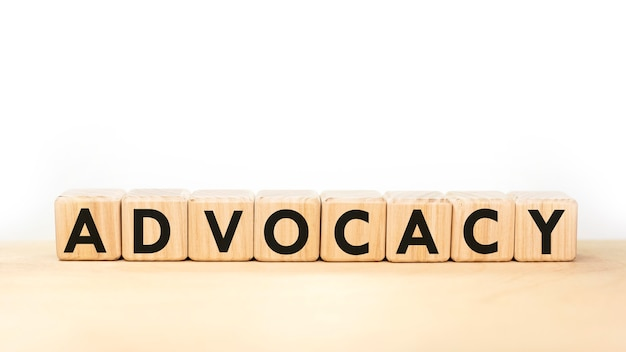 Word advocacy on wooden blocks on white background.