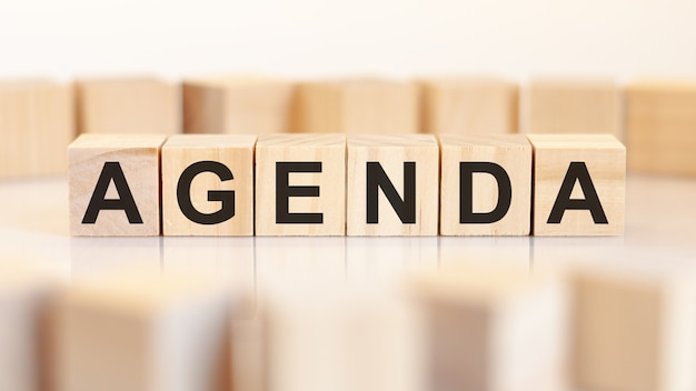 The word agenda is written on a wooden cubes structure