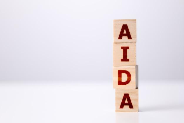 ウッドビルディングブロックビジネスコンセプトと単語aida