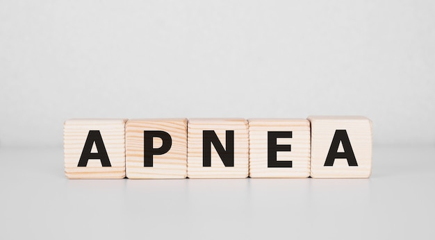 Word apnea written on wood block. business concept