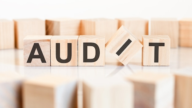 The word audit is written on a wooden cubes structure. business and financial concept.