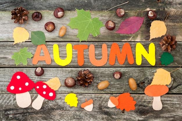 Word autumn, leaves, mushrooms, acorns made of felt