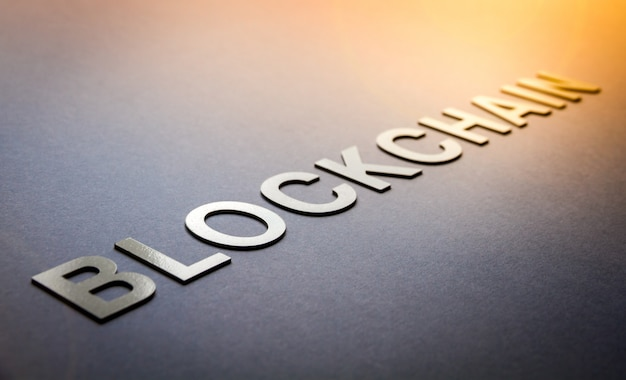 Word blockchain written with white solid letters