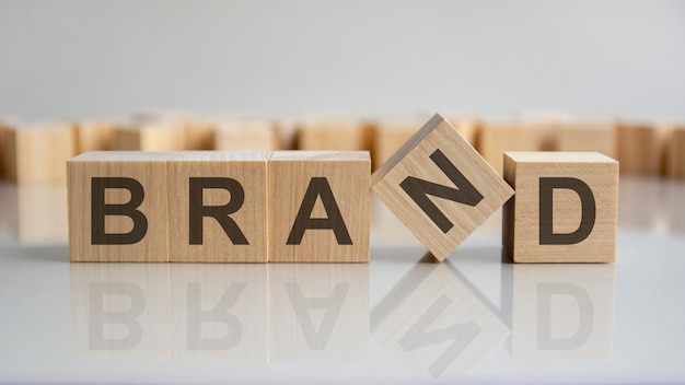 Word brand on wooden cubes, gray background