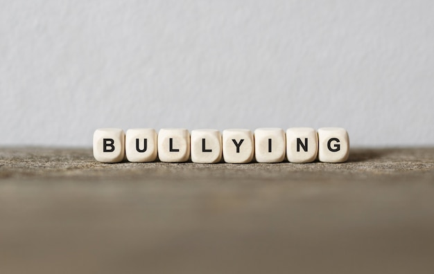 Word bullying made with wood building blocks, stock image