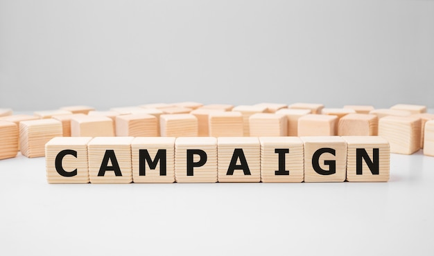 Word campaign made with wood building blocks