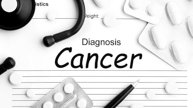 紙、聴診器、丸薬、錠剤、カプセルの単語癌