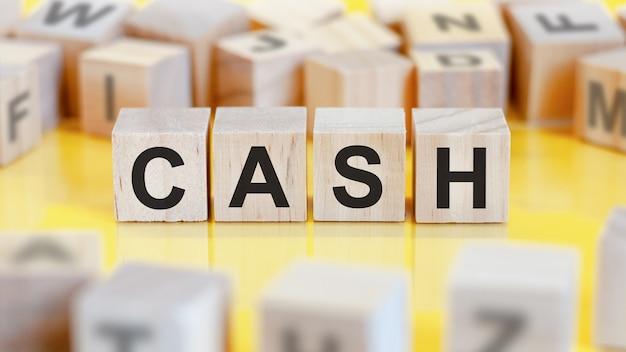 Word cash written on wood blocks, concept.
