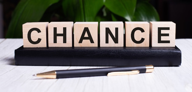 The word chance is written on the wooden cubes of the diary near the handle