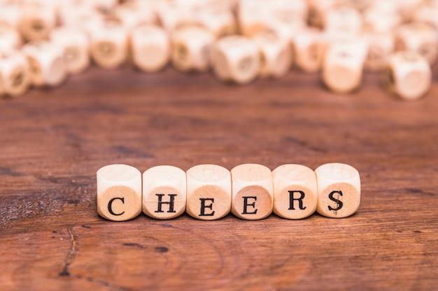 The word cheers written on wooden block shape