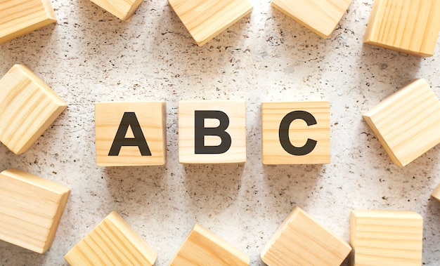 The word consists of wooden cubes with letters, top view on a light background. work space.