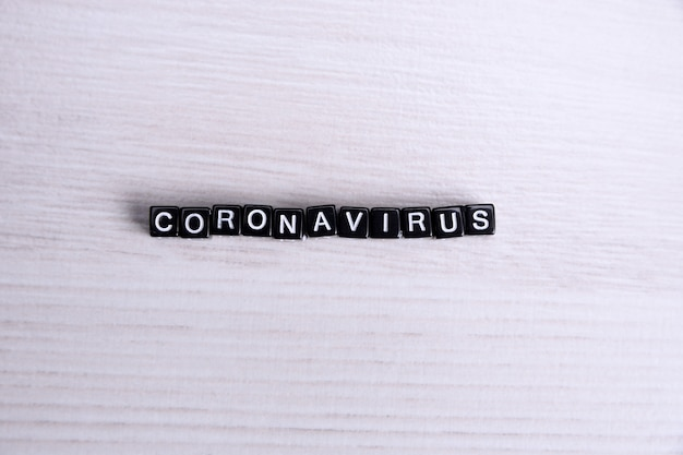 Word coronavirus laid with cubes letters flat lay composition